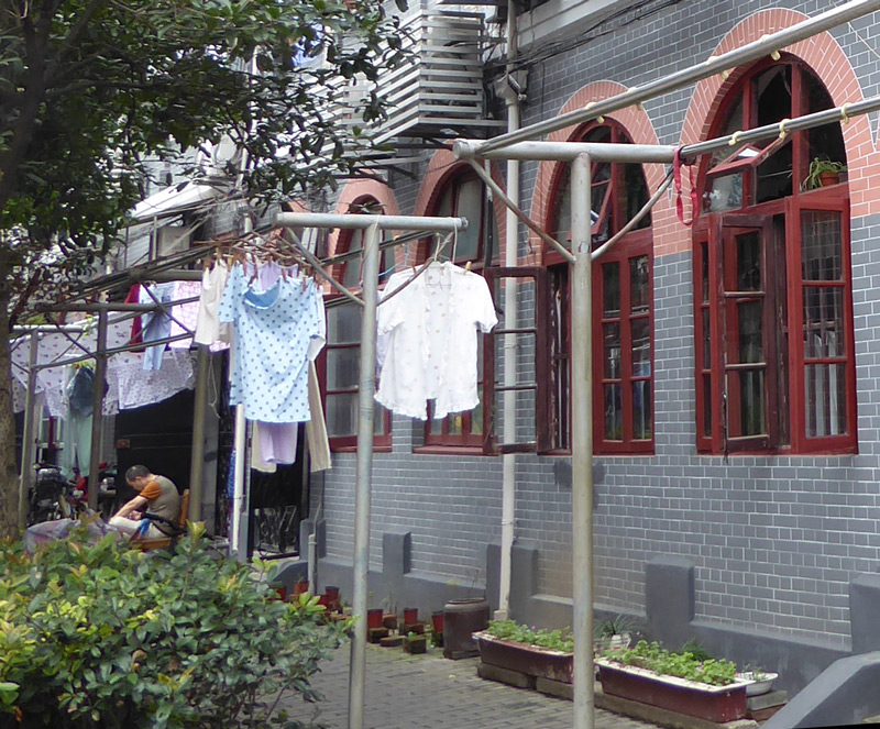 Hanging up laundry in the streets of shanghai