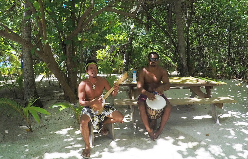 singing and drumming while dining