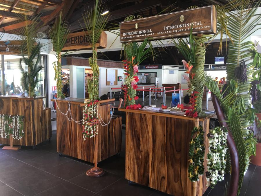 bouquets of flowers to the hotel's guests at the airport on the island of Bora Bora